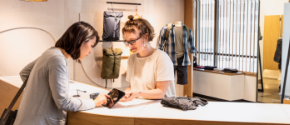 Image showing a customer purchasing some clothes in a retail store.