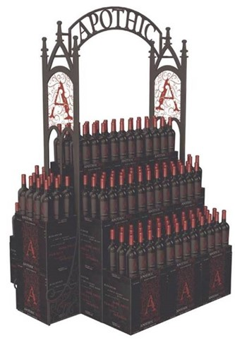 Display of wine bottles stacked on a riser that has the branding for Apothic wine