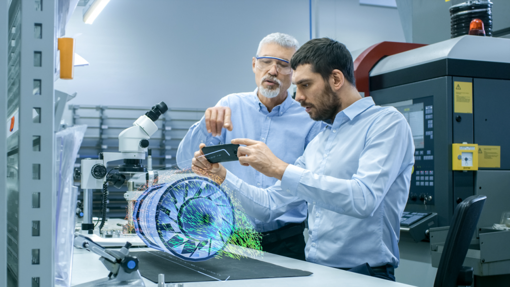 Two employees looking at a holographic wind turbine