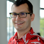 Picture of a smiling man in glasses and a Hawaiian shirt, Jedrzej Osinski