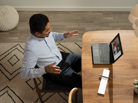The future of work includes accessibility: A man sitting at a desk on a Teams meeting