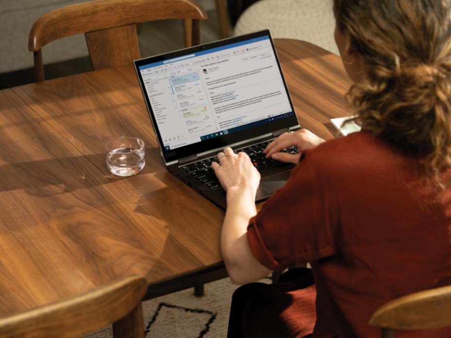 Future of work includes remote working: A person sitting at a table with a laptop