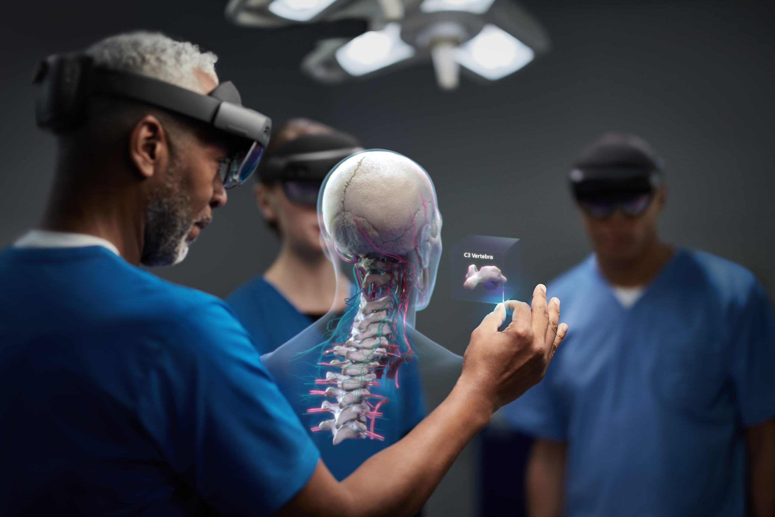 Surgeon and medical team, using HoloLens 2 to assist in an operating theatre.