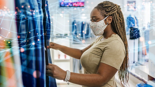 Women in a mask, shopping for curtains.
