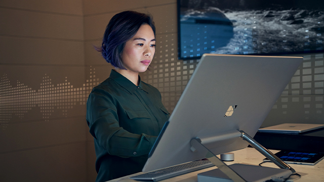 Woman working on a Surface device.
