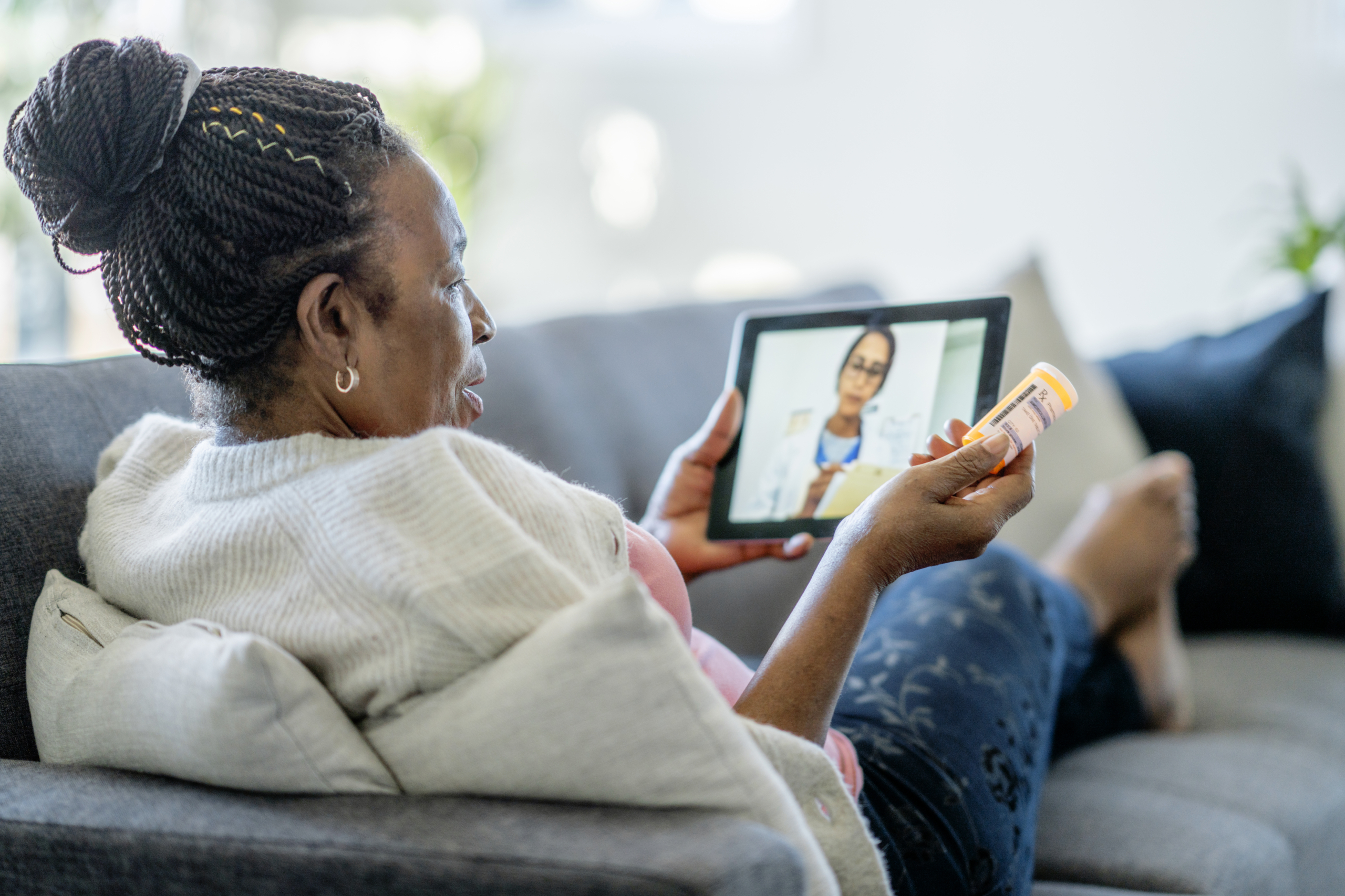 Telemedicine call between a senior woman and her doctor.