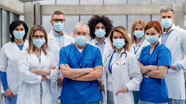 Group of nurses and doctors with facemasks.