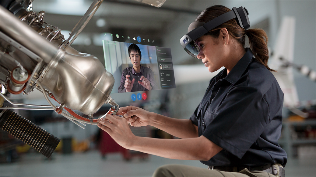 Woman using Microsoft Dynamics 365 Remote Assist in a manufacturing setting.
