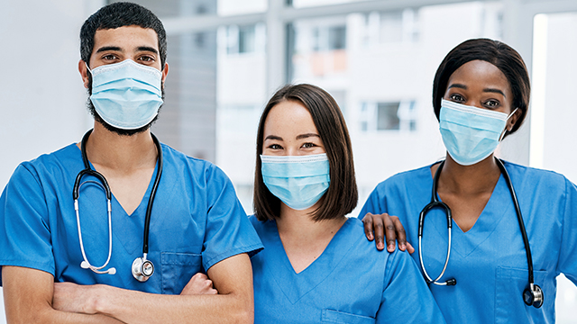 Three doctors with facemasks.