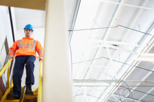 A man on a work site with a hard hat.