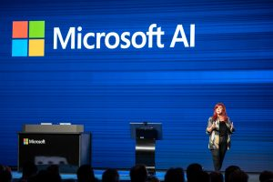 Mitra Azizirad , Microsoft executive, speaking on Microsoft AI stage at an event