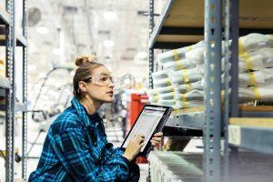 Employee with tablet in warehouse