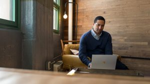 Small business male achieving with a Surface in modern workplace.