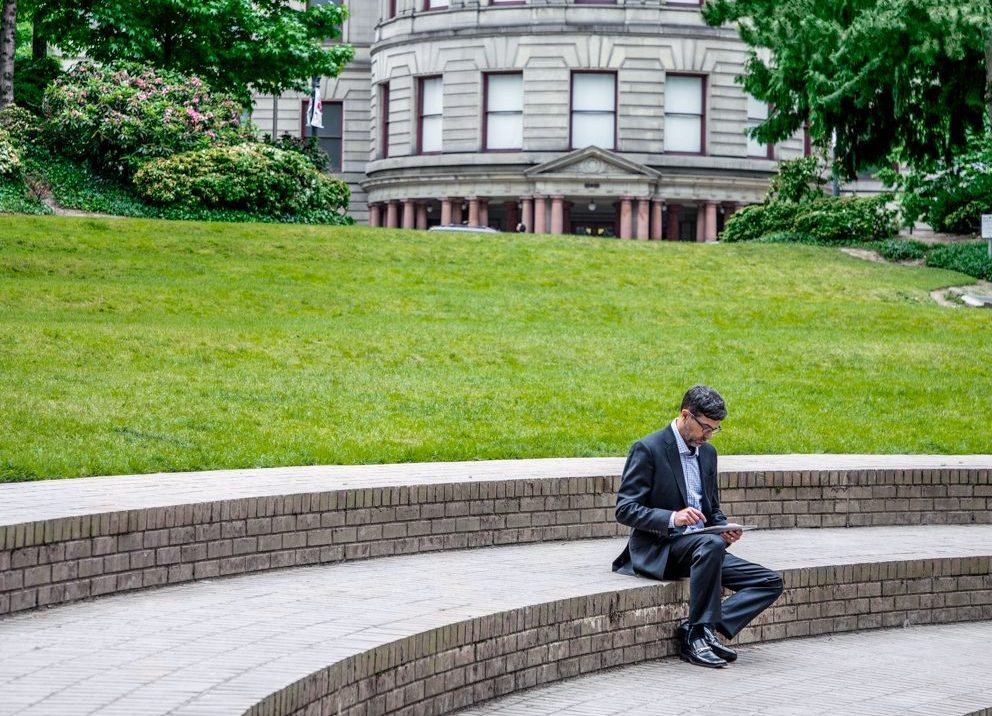 Man working outside of Government building