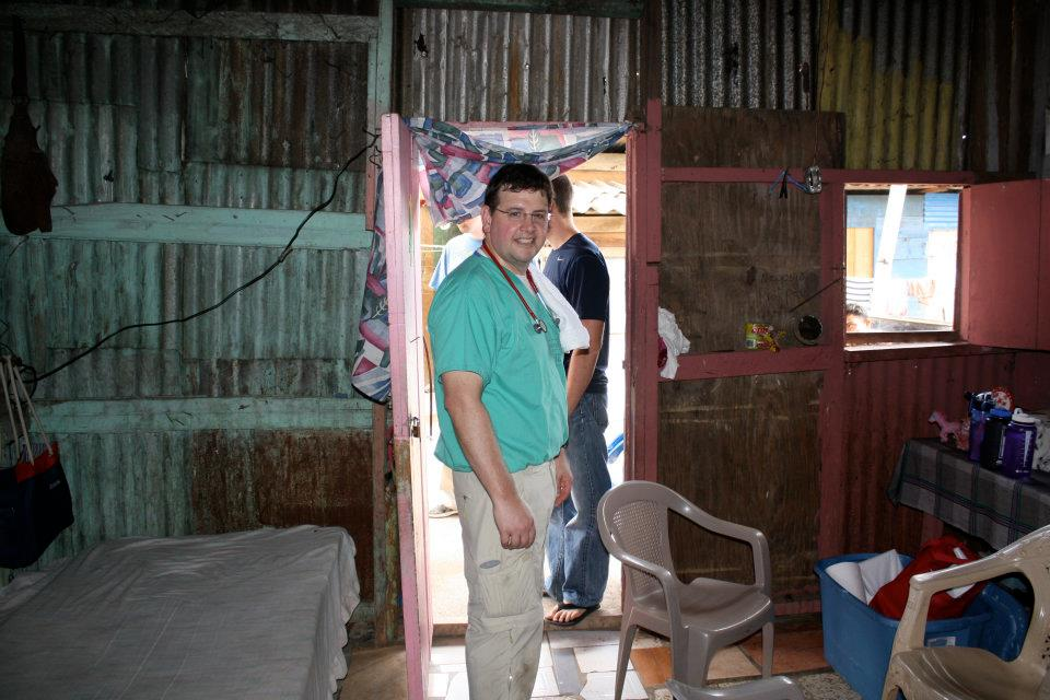 Greg Moore preparing for a Honduran village volunteer medical clinic in the home of a family who generously offered it for use for the day.