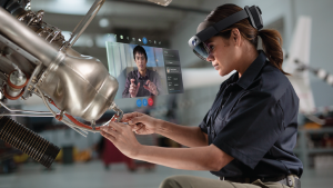 Woman using Hololens to work on machinery
