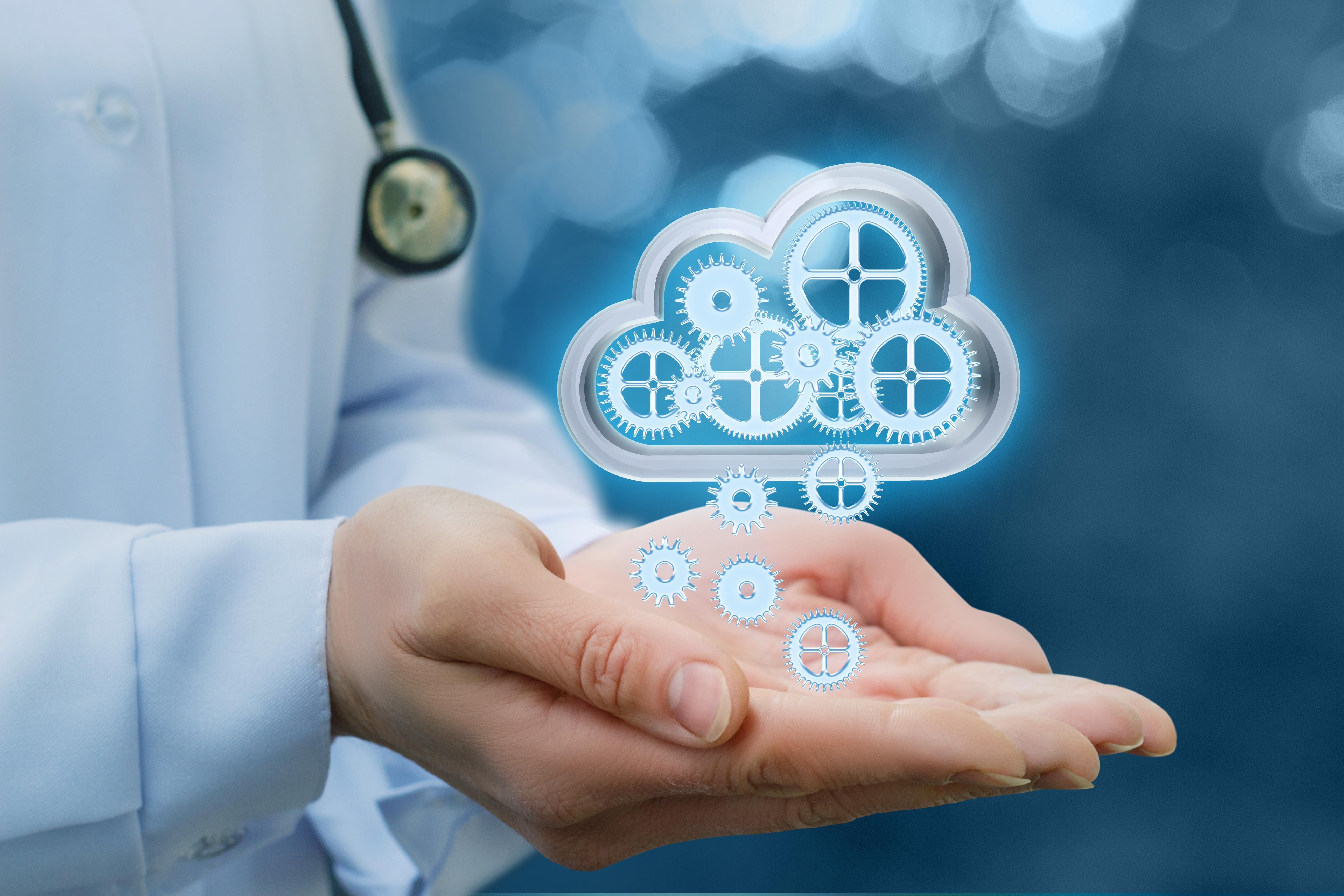 An image of a doctor with palms out holding a virtual computing cloud