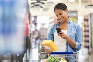 Woman uses grocery store mobile app while shopping