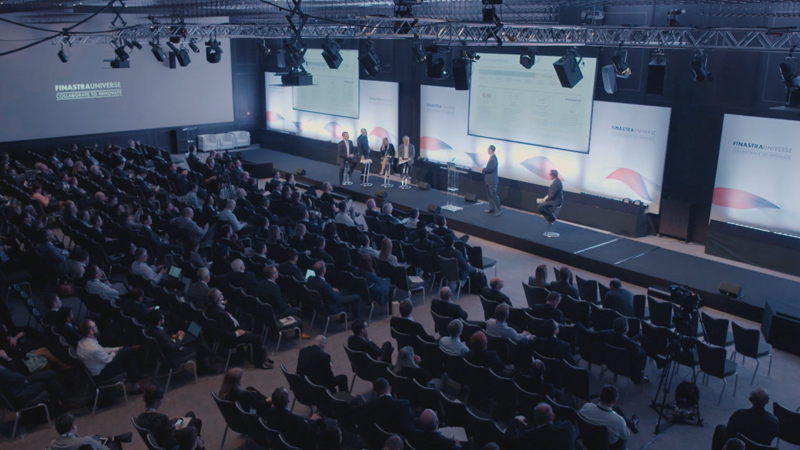 A large crowd attend a Finastra panel.