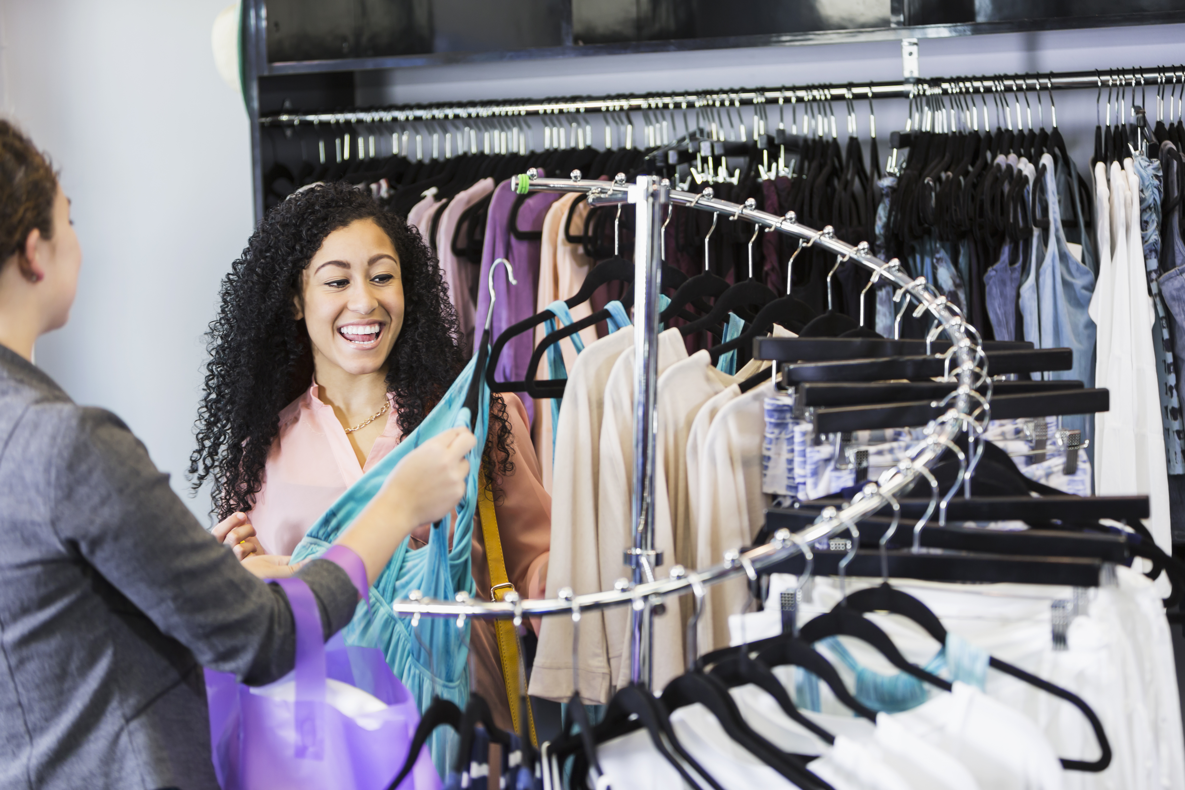 Women shopping for clothes in clothing store