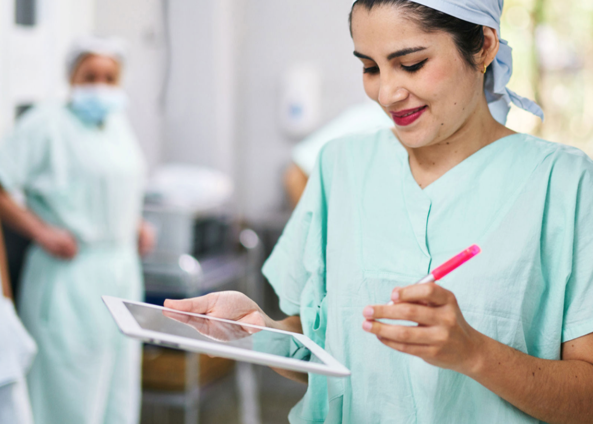 Healthcare employee working with device