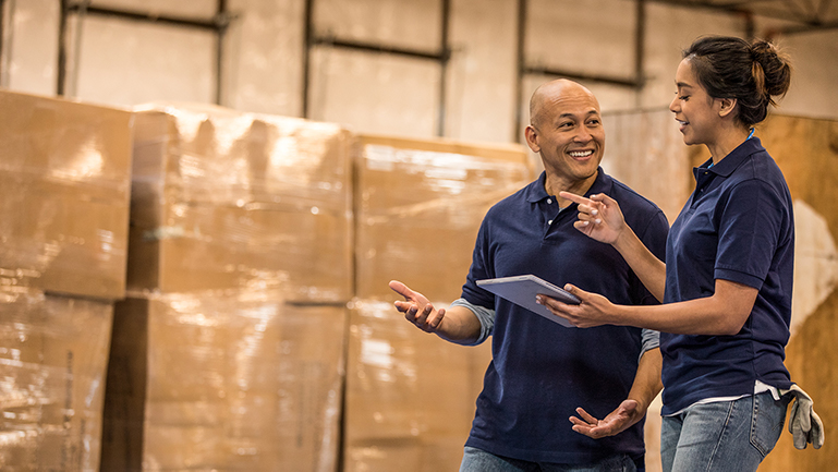 Two employees working in a warehouse