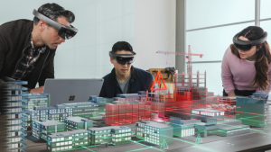 Group exploring a digital twin of a city power grid hologram with Microsoft HoloLens for the purpose of situation response to public utility emergency