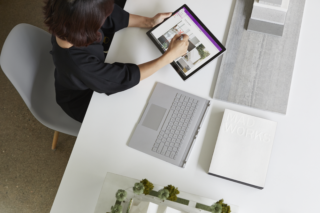 Woman working on a Surface Book, using OneNote