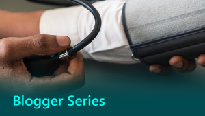 Blogger series graphic showing a doctor checking patient's blood pressure.