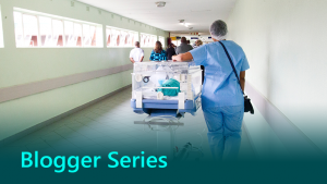 Blogger series thumbnail showing hospital staff in a hospital corridor.