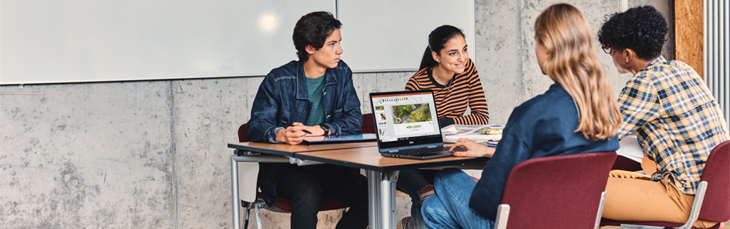 Students sitting around a table, collaborating on a group project