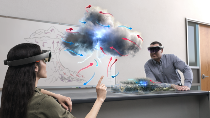 Male and female coworkers use AI and HoloLens to look at cloud formations