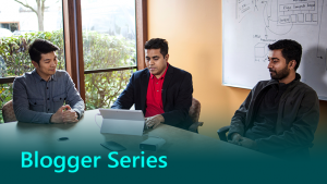 Blogger series graphic showing two man working at a table.