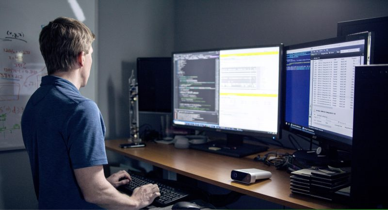 Software developer typing at a computer.
