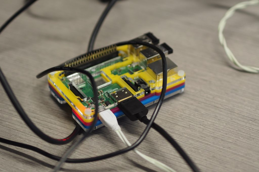 A Raspberry Pi device, with cables attached.