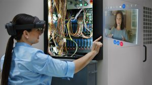Woman interacing with Remote Assist hologram in a wiring project. Lifestyle photography. Contextual imagery.