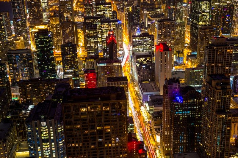 Bird's eye view of downtown Chicago city skyline at night