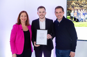 Tom Light holding Microsoft apprenticeships graduation certificate with Clare Barclay, Microsoft UK COO, and Gary Neville