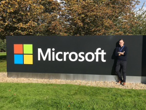 Tom standing by the Microsoft sign on the first day of his apprenticeship