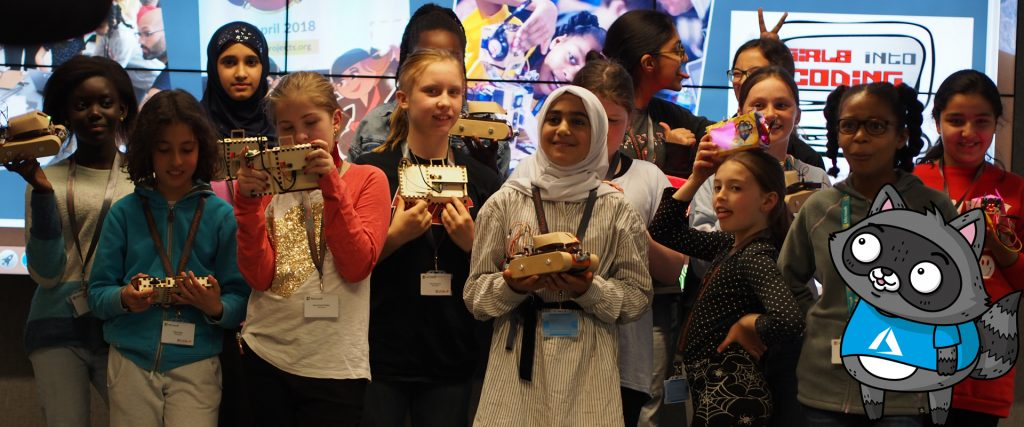 Ayve and a group of girls holding their creations at the third Girls into Coding event.