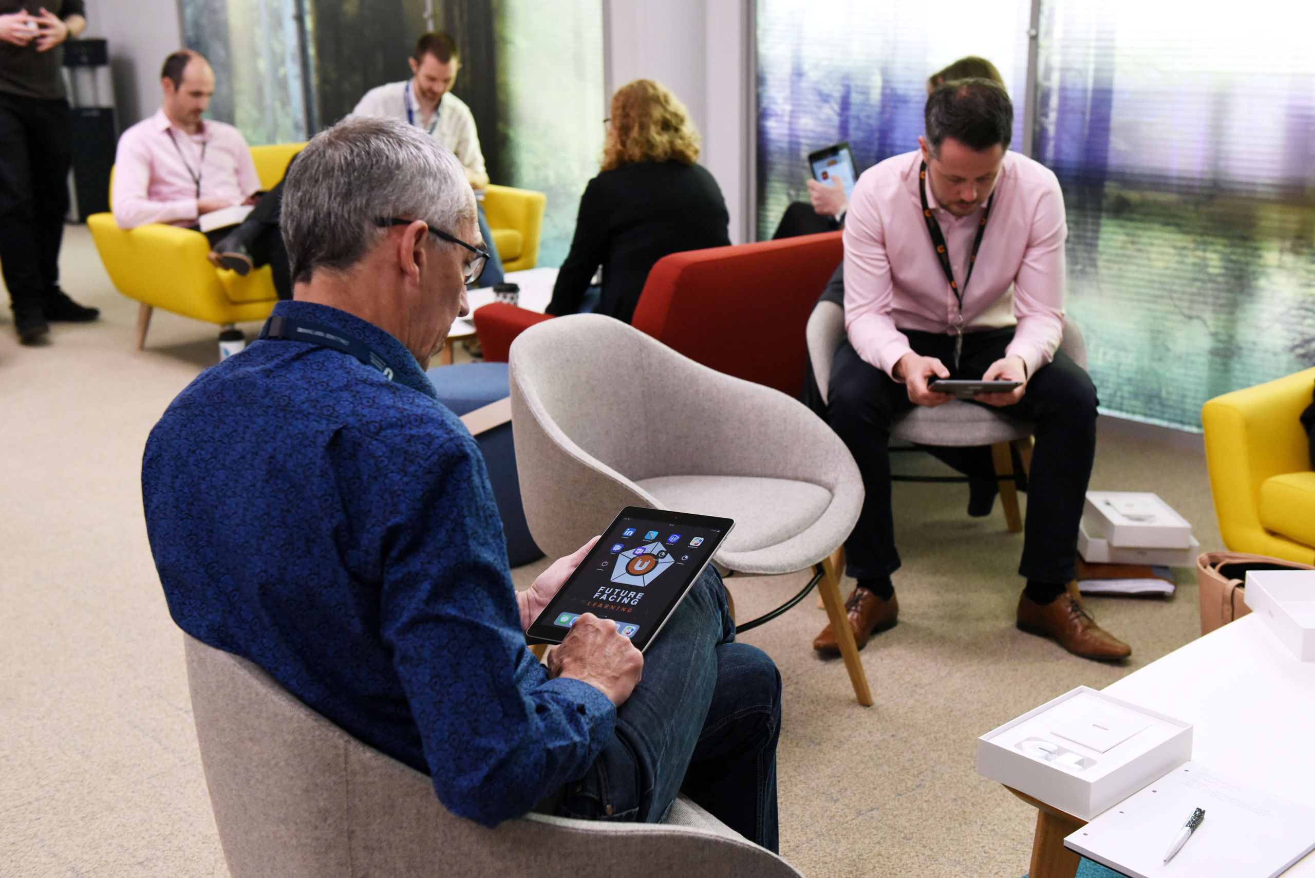 Man sat in a chair using the future facing learning platform