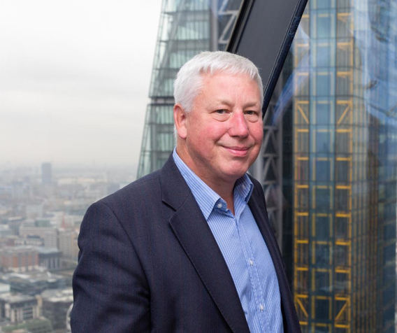 Headshot of Jonathan Papworth with the city in the background.
