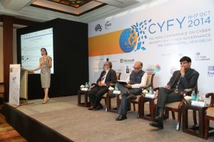 Angela McKay, Director of Cybersecurity Policy, delivers her keynote address with seated attendees: Dr. C. Raja Mohan, Head, Strategic Studies and Distinguished Fellow, ORF; Arvind Gupta, Deputy National Security Advisor, Government of India; and Samir Saran, Sr. Fellow & Vice President, ORF.