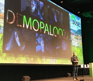 Michael Miller on stage, kicking off Demopalooza at SUSECON