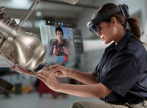 Woman using Dynamics 365 Remote Assist with HoloLens 2.