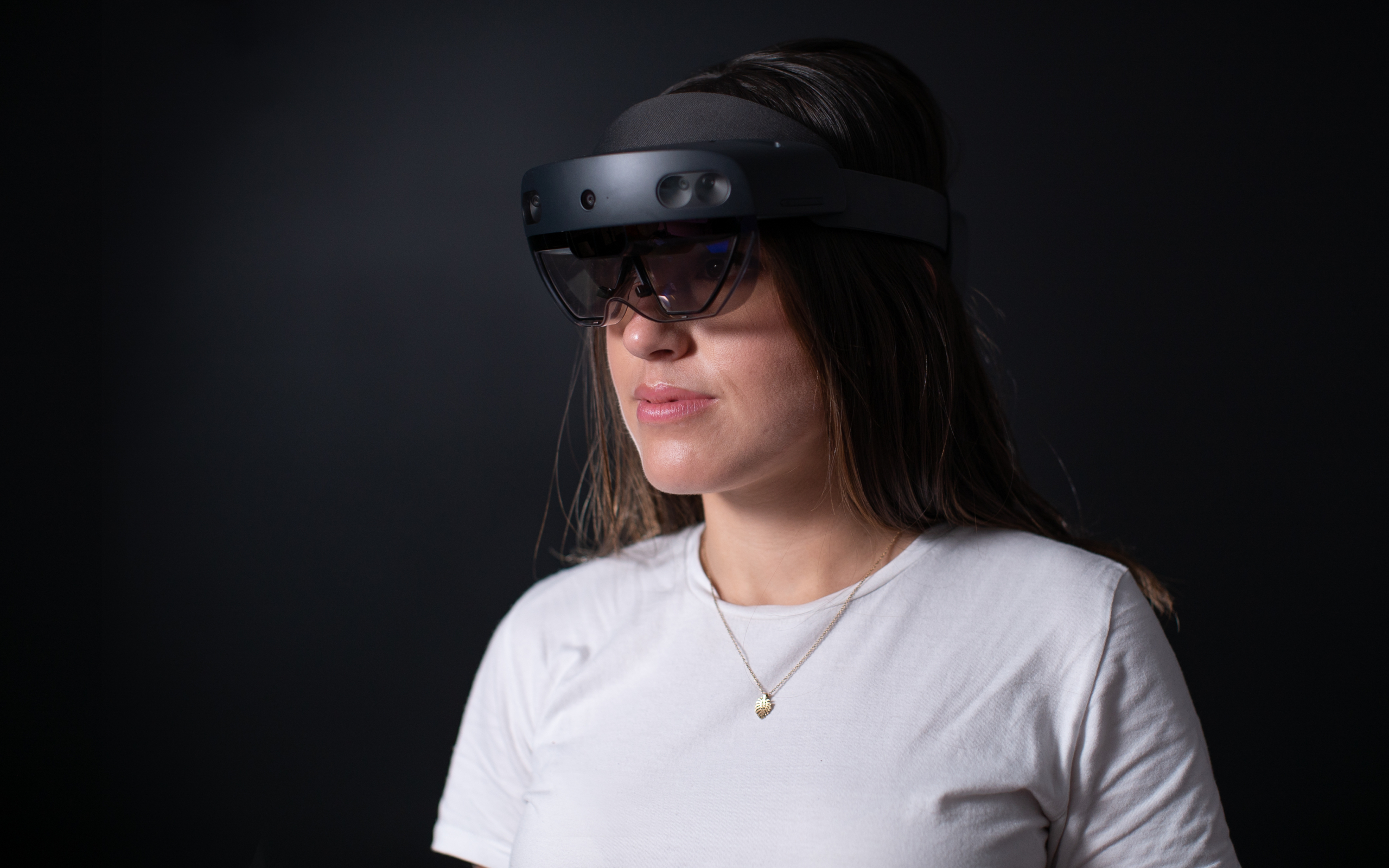 A picture of Melissa wearing a Microsoft HoloLens