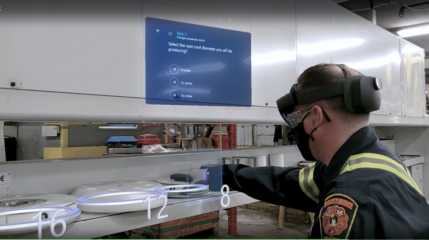 A worker wearing Microsoft HoloLens with a Dynamics 365 Guides prompt displayed