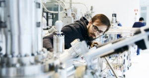 Materials scientists using state of the art lab equipment to synthesize quantum crystals