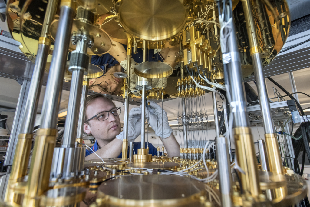 Researcher working on quantum hardware